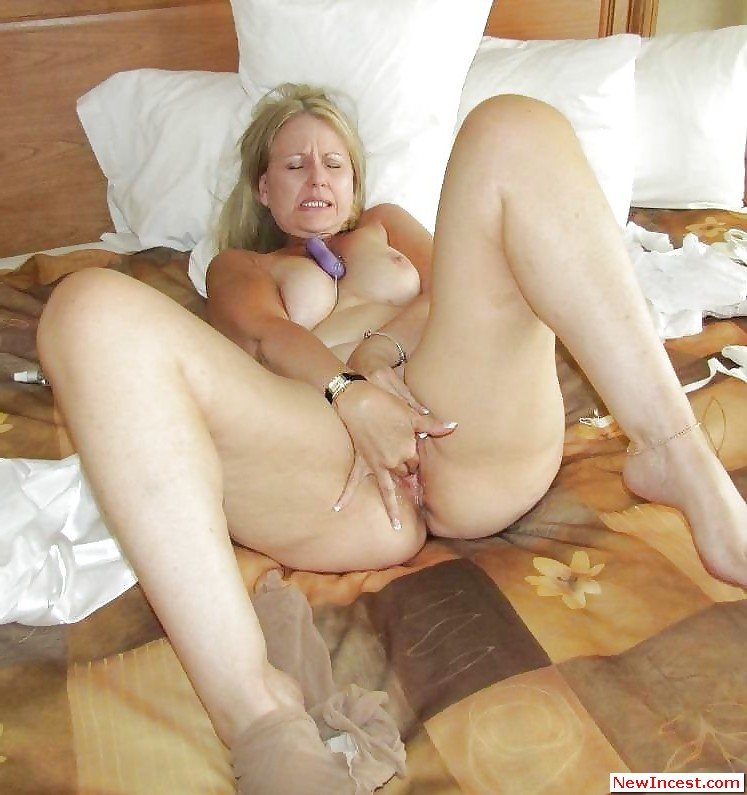 mom caressing sons balls